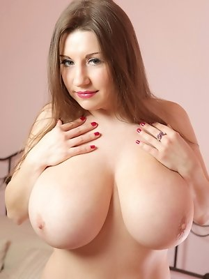 Samantha's big firm all-natural breasts  are a force of nature, and her sexy girl next-door good looks make her even more ravishingly appealing,